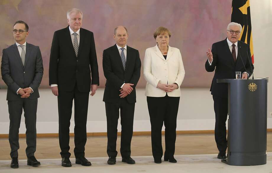 "Chancellor Angela Merkel (second from right) is the European Union's longest-serving leader. She was sworn in Wednesday at the head of a ""grand coalition"" of Germany's biggest parties. Photo: Wolfgang Kumm, Associated Press"