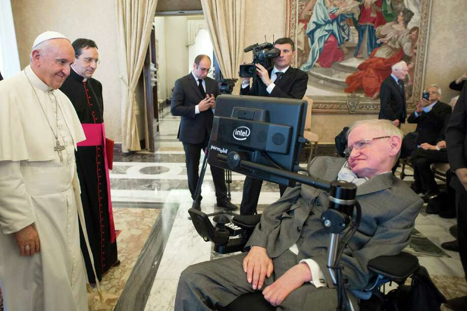 FILE - In this Monday, Nov. 28, 2016 file photo Pope Francis greets physicist Stephen Hawking during an audience with participants at a plenary session of the Pontifical Academy of Sciences, at the Vatican. Hawking, whose brilliant mind ranged across time and space though his body was paralyzed by disease, died Wednesday, March 14, 2018. (L'Osservatore Romano/pool photo via AP, File) Photo: OSSERVATORE ROMANO PRESS OFFICE, AP / Copyright 2016 The Associated Press. All rights reserved.