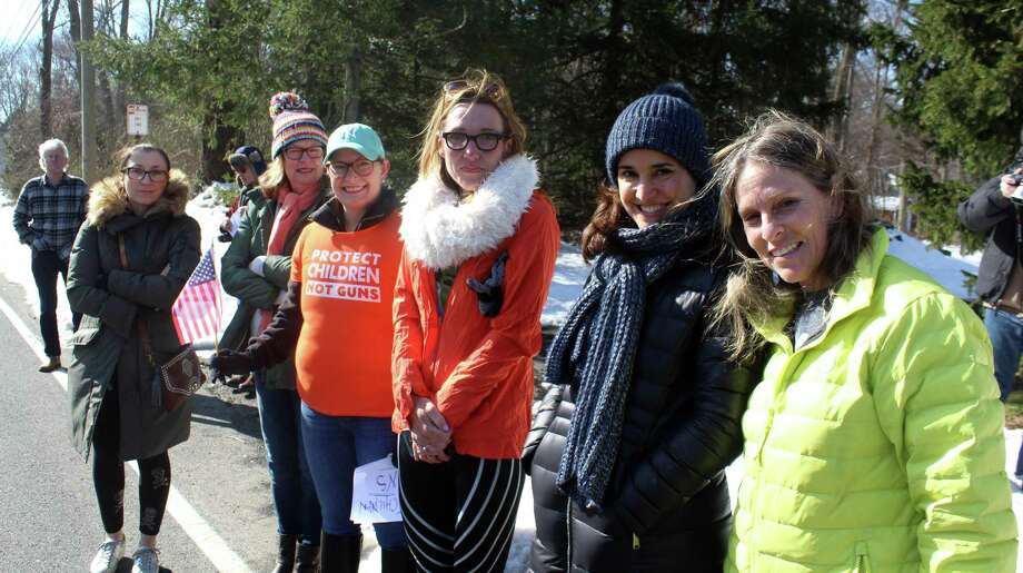 Westport parents gather across from Staples High School on Wednesday in support of the student-led walkout against gun violence. Photo: Sophie Vaughan / Hearst Connecticut Media / Fairfield Citizen