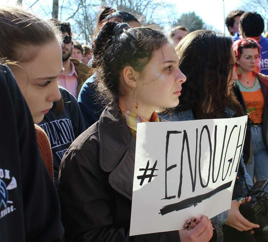 Wilton High students walked out of school on Wednesday, March 14, in protest of gun violence. The walkout was a part of a national movement, scheduled a month after 17 people were killed by a gunman at Marjory Stoneman Douglas High School in Florida. Photo: Pat Tomlinson / Hearst Connecticut Media