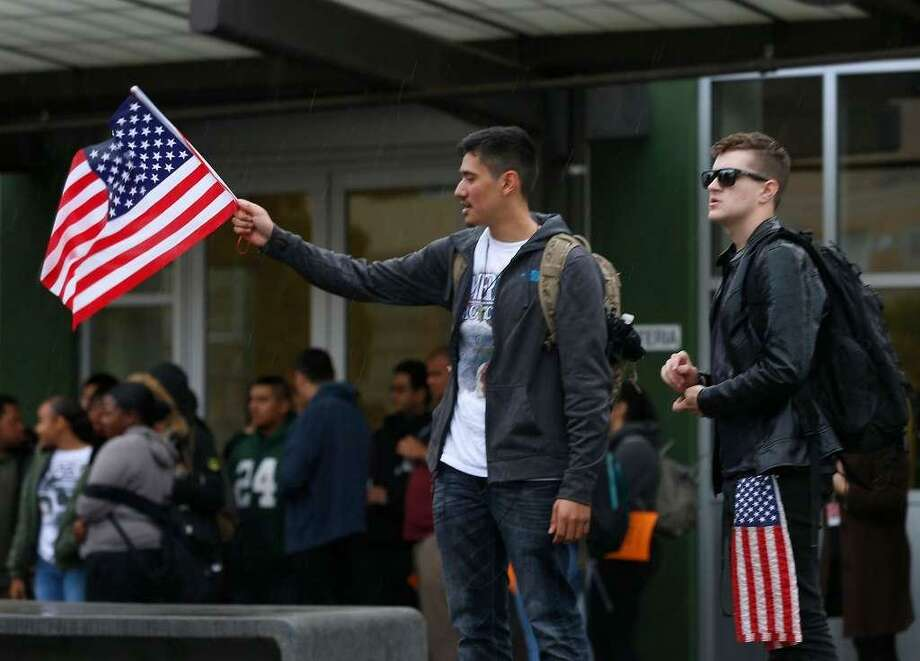 Daniel Reales, left, and Diego Anderson attend a rally at El Cerrito High School on Wednesday. Both say they oppose high gun control but came to honor the victims who died in last month's school shooting in Florida. Photo: Paul Chinn / The Chronicle / The Chronicle