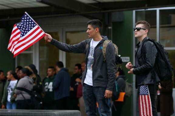 Daniel Reales, left, and Diego Anderson attend a rally at El Cerrito High School on Wednesday. Both say they oppose high gun control but came to honor the victims who died in last month's school shooting in Florida.