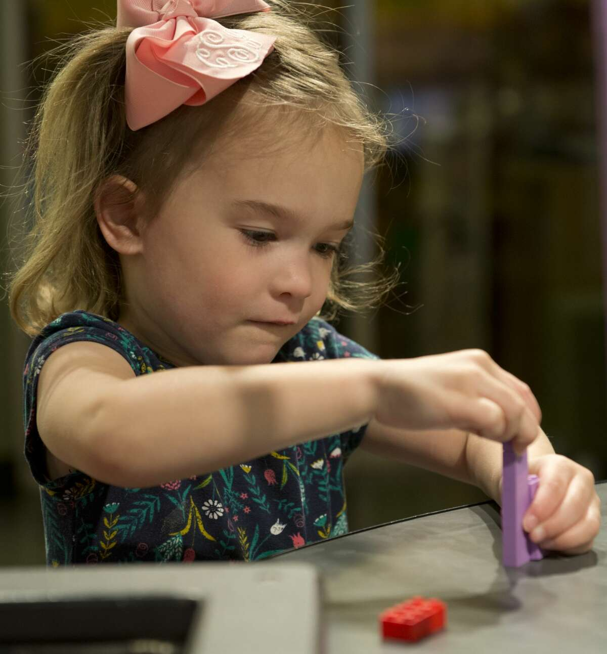 Clara South, 3, works on a project 03/14/18 at the DreamBuildGo Travel Adventure Lego exhibit at the Midland County Library Centennial Branch.The exhibit will be open till April 21.Tim Fischer/Reporter-Telegram