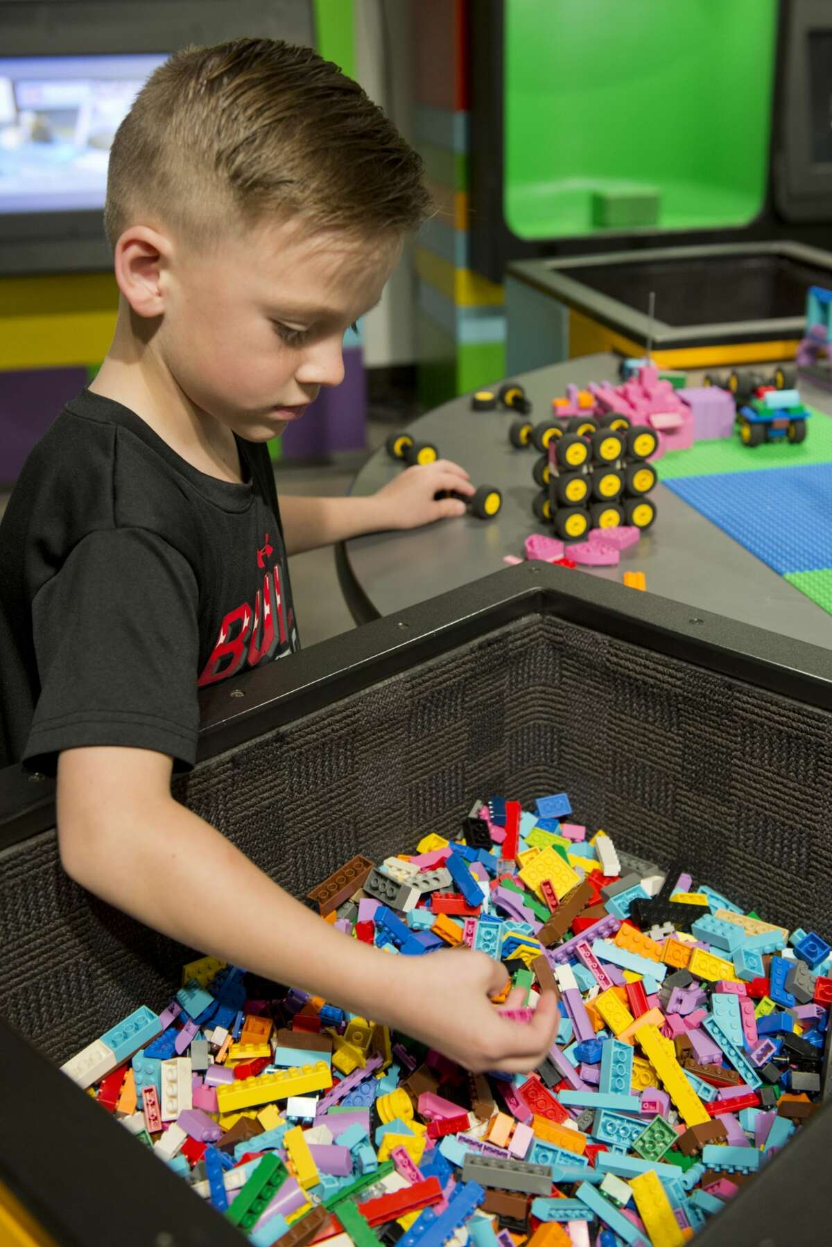 Max Maher looks for more wheels for his build 03/14/18 at the DreamBuildGo Travel Adventure Lego exhibit at the Midland County Library Centennial Branch.The exhibit will be open till April 21.Tim Fischer/Reporter-Telegram