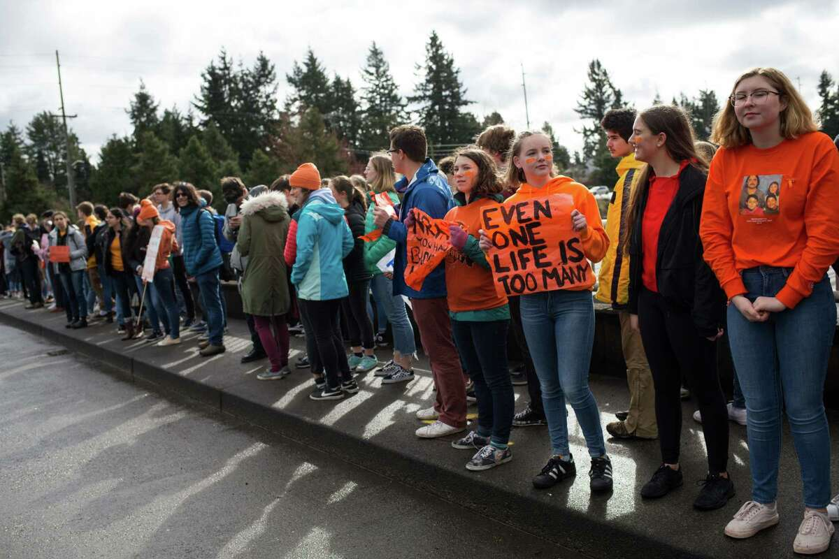 Students from Ingraham High School line an overpass above I-5 during a nationwide student walkout to protest gun violence and advocate for more gun control legislation, on Wednesday, March 14, 2018.