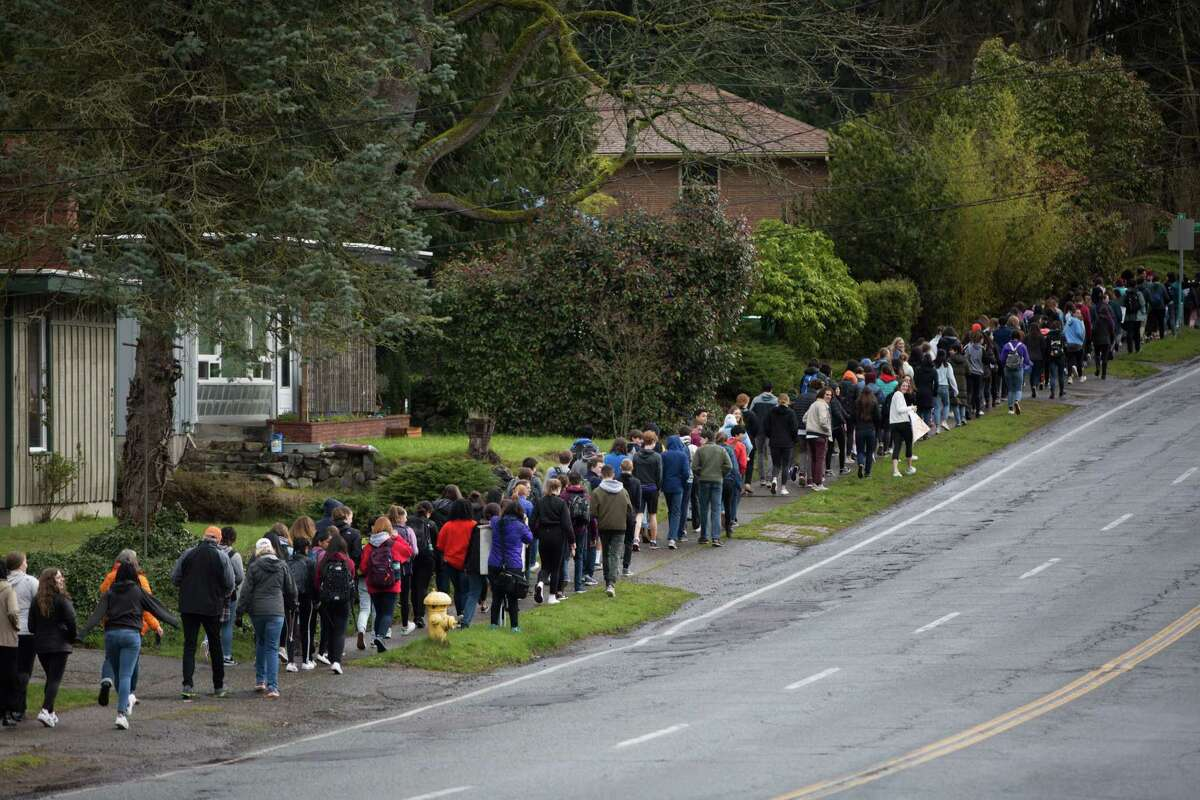 Hundreds of students from Ingraham and Lakeside high schools to the nearest overpass above I-5 to call for an end to gun violence through an increase in gun control, during a nationwide student walkout on Wednesday, March 14, 2018.