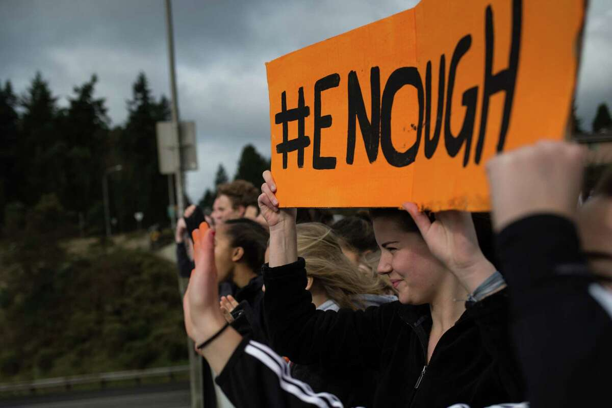 Students from Ingraham High School protest on an I-5 overpass during a nationwide student walkout to protest gun violence and advocate for more gun control legislation, on Wednesday, March 14, 2018.