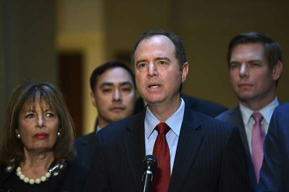 House Intelligence Committee ranking member Rep. Adam Schiff, D-Calif., center, speaks to reporters on Capitol Hill in Washington, Tuesday, March 13, 2018. Schiff is joined by other Democrats on the committee. (AP Photo/Susan Walsh)