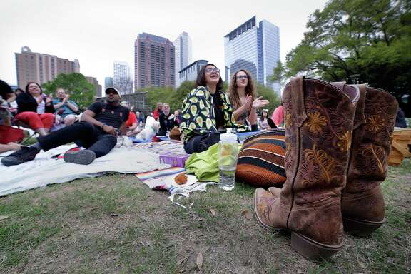 Boots sit unworn as the audience listens to Rosewood Thievz perform at Canned Acoustica on Discovery Green Sunday Mar. 11, 2018, in Houston, TX (Michael Wyke / For the  Chronicle)