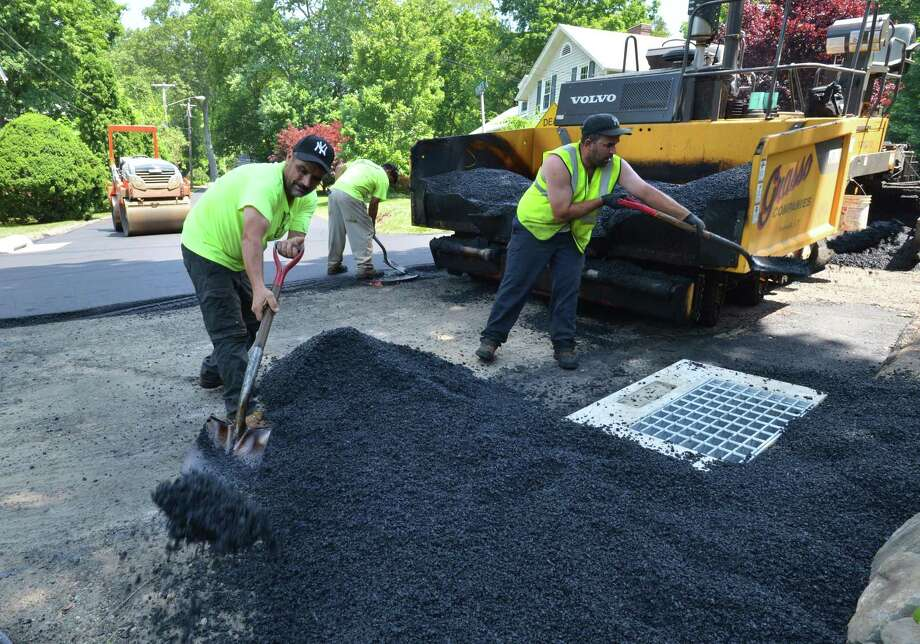 A crew from The Grasso Companies hard at work paving Jarvis Street last year. Photo: Alex Von Kleydorff / Hearst Connecticut Media / Norwalk Hour