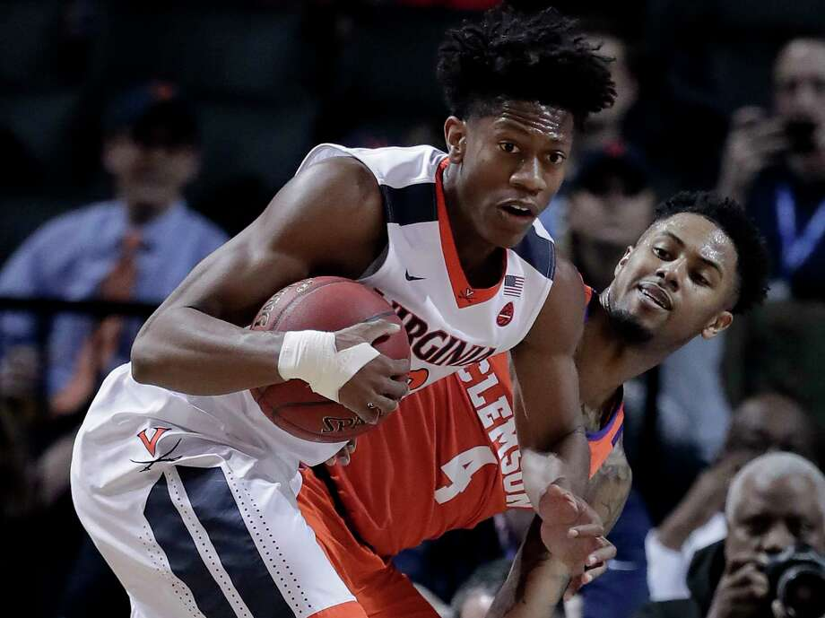 FILE - In this Friday, March 9, 2018, file photo, Virginia guard De'Andre Hunter (12) pulls down a rebound next to Clemson guard Shelton Mitchell (4) during the first half of an NCAA college basketball game in the semifinals of the Atlantic Coast Conference tournament in New York. Hunter, the ACC's sixth man of the year, will miss the NCAA tournament with a broken left wrist. The school says Hunter suffered the injury during the ACC tournament, but did not say how. (AP Photo/Julie Jacobson, File) Photo: Julie Jacobson, STF / Copyright 2018 The Associated Press. All rights reserved.