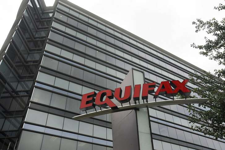 FILE - This July 21, 2012, file photo shows Equifax Inc., offices in Atlanta. A former Equifax executive who sold stock for nearly $1 million before the company's massive data breach was publicly announced faces insider trading charges. Federal prosecutors announced Wednesday, March 14, 2018, that a grand jury indicted Jun Ying, the former chief information officer of Equifax's U.S. Information Solutions. (AP Photo/Mike Stewart, File)