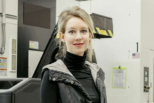 FILE - Elizabeth Holmes at the Theranos facility in Newark, Calif., Dec. 4, 2015. Holmes, the founder and chief executive of the blood-testing company, was charged with fraud by the Securities and Exchange Commission on March 14, 2018, for raising more than $700 million from investors by falsely promoting a key product, the commission said. (Carlos Chavarria/The New York Times)