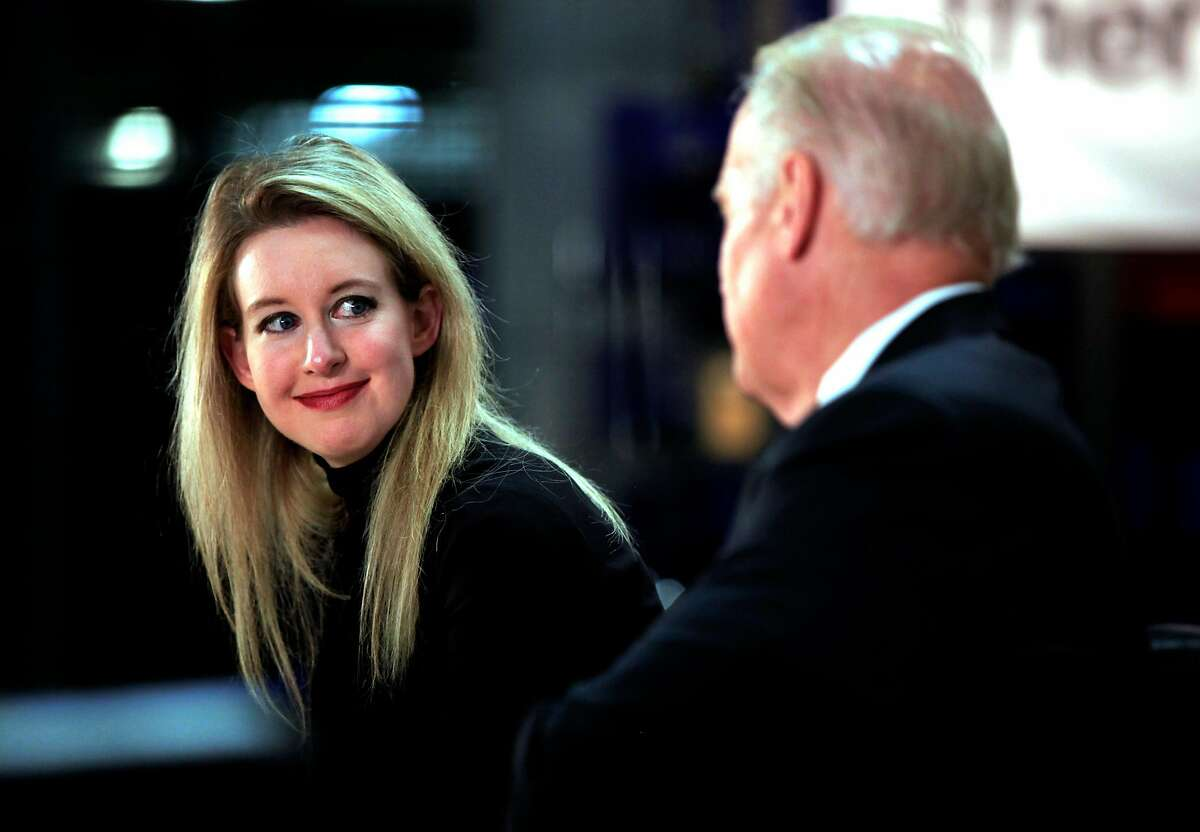 Elizabeth Holmes, CEO of Theranos, watches Vice President Joe Biden speak to a crowd of Theranos employees and health care industry personnel during a roundtable event in Newark, California, on Thursday, July 23, 2015.
