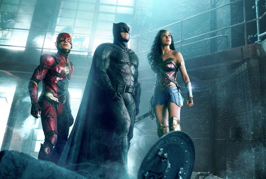 """From left, Ezra Miller as the Flash, Ben Affleck as Batman and Gal Gadot as Wonder Woman in """"Justice League."""" MUST CREDIT: Warner Bros. Pictures / Warner Bros. Pictures"""