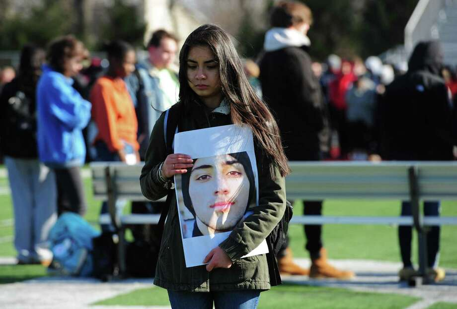 Norwalk High School students including junior Adriana Gudiel as well as school staff and guests gather on the football field for a reading of names and a moment of silence for those who died in the Parkland, Florida school shooting Wednesday, March 14, 2018, at the high school in Norwalk, Conn. Photo: Erik Trautmann / Hearst Connecticut Media / Norwalk Hour