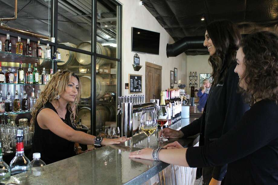 Carol Bertagna pours samples of Pinot Grigio and Syrah Rosé at her family's Almendra Winery in Durham. Photo: Harriot Manley, Special To The Chronicle