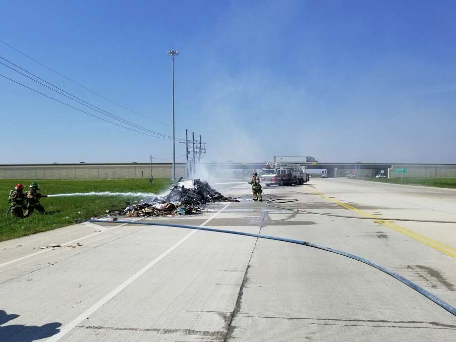 A commercial trash truck's load was dumped on the side of the road due to the driver's quick reaction when he noticed smoke coming from the back of his truck. Wednesday, March 14, 2018. Photos: Beaumont Fire and Rescue Photo: Beaumont Fire And Rescue