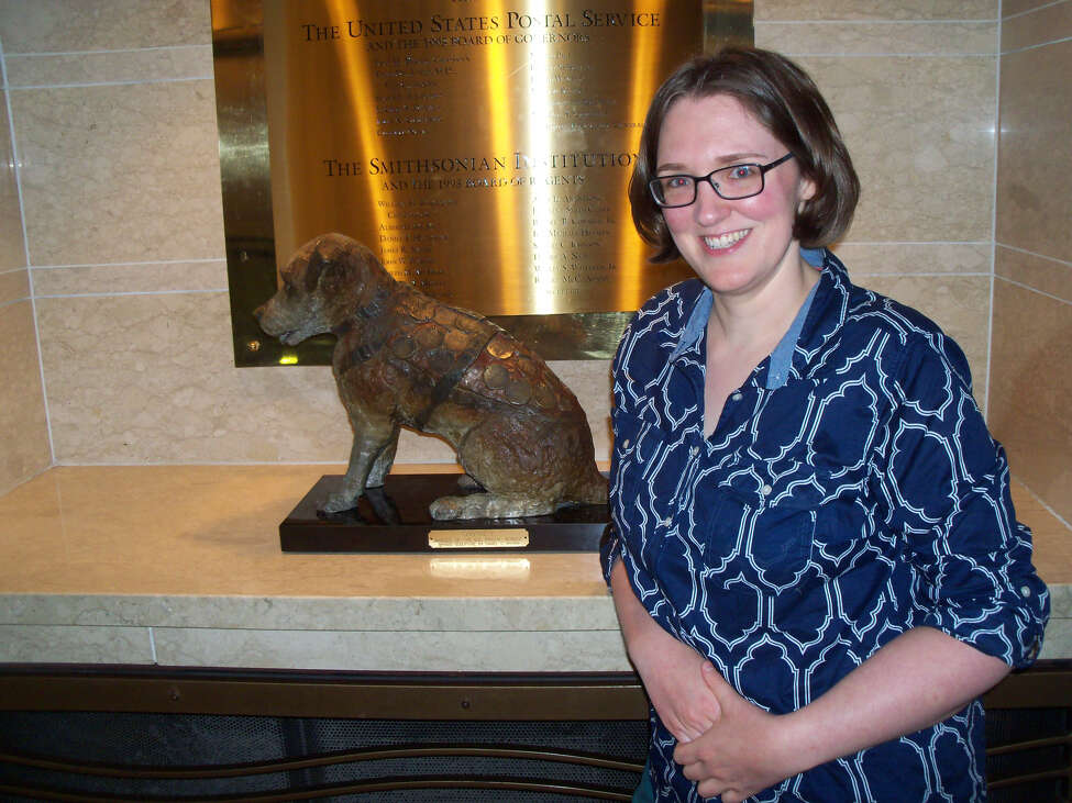 Historian and author Kelli Huggins with a statue of the Albany-based railroad dog Owney at the National Postal Museum. The museum also has Owney's preserved body on view. (Photo courtesy Kelli Huggins.)