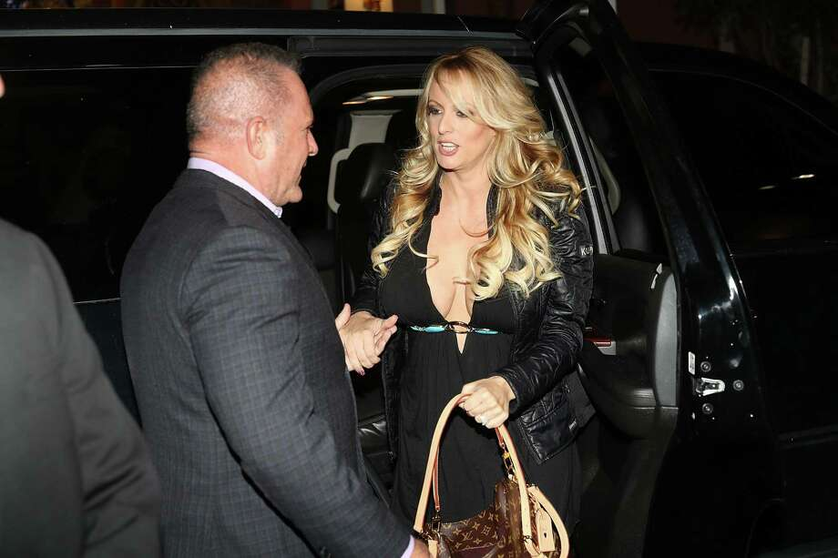 The porn actress Stephanie Clifford, who uses the stage name Stormy Daniels, arrives to perform at the Solid Gold Fort Lauderdale strip club on March 9, 2018 in Pompano Beach, Florida. Her lawsuit against Trump's forced non-disclosure agreement with her, might be the undoing of the president. Photo: Joe Raedle / / 2018 Getty Images