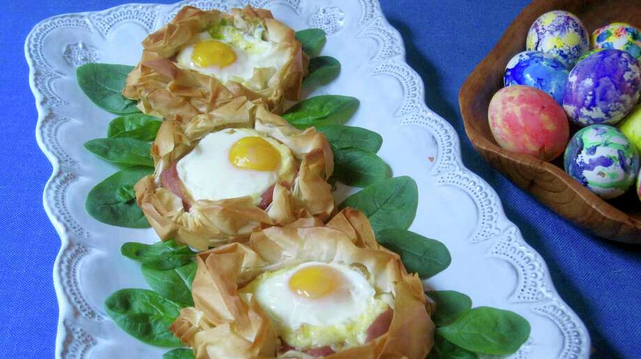 This March 2018 photo shows eggs baked in pastry nests made of phyllo in New York. This dish is from a recipe by Sara Moulton. (Sara Moulton via AP) Photo: Sara Moulton / Sara Moulton