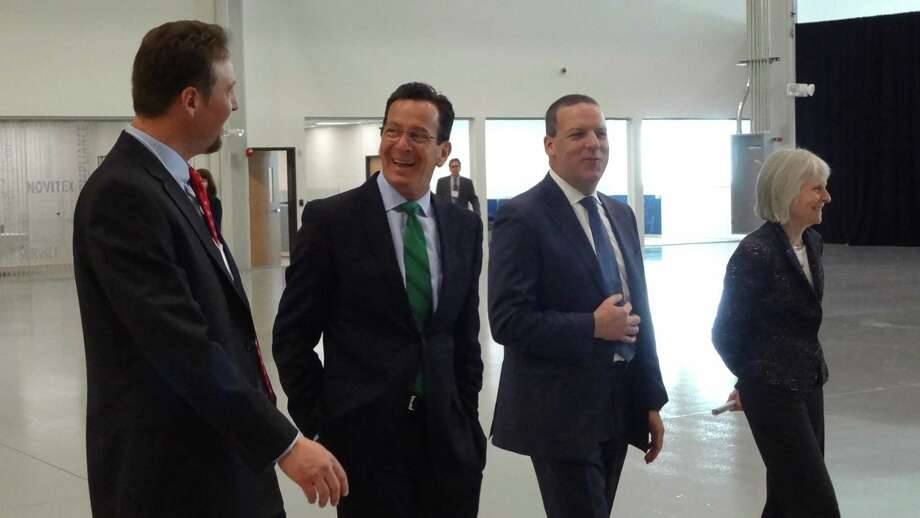 Former Novitex Enterprise Solutions CEO John Visentin (center right) accompanies Gov. Dannel P. Malloy (center left) in March 2015 on a tour of a Windsor document processing facility. On March 14, 2018, activist investor Carl Icahn announced the hire of Visentin to lead his proxy contest to stop the sale of Xerox to Fujifilm Holdings. Photo: Alexander Soule / Alexander Soule / Stamford Advocate