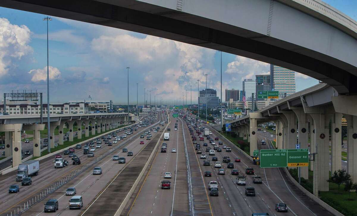 Lanes of Interstate 10 stretch out looking east toward downtown Houston from the entrance ramp to the Sam Houston Tollway southbound on July 19, 2017.