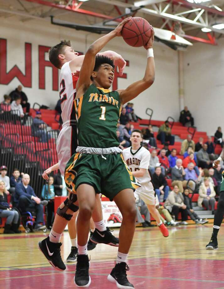 Stephon McGill (1) of the Trinity Catholic Crusaders pulls down a rebound during a game against the Fairfield Warde Mustangs at Fairfield Warde High School on Thursday February 1, 2018 in Fairfield, Connecticut. Photo: Gregory Vasil / For Hearst Connecticut Media / Connecticut Post Freelance