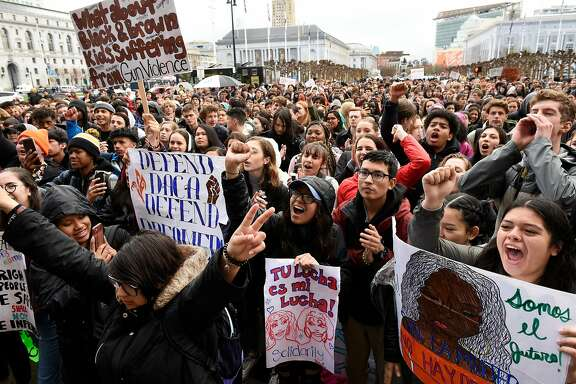 Students cheer as they gather in from of City Hall to oppose gun violence,  in San Francisco, Calif., on Wednesday March 14, 2018. Students across the country participate in a national walkout to oppose gun violence.