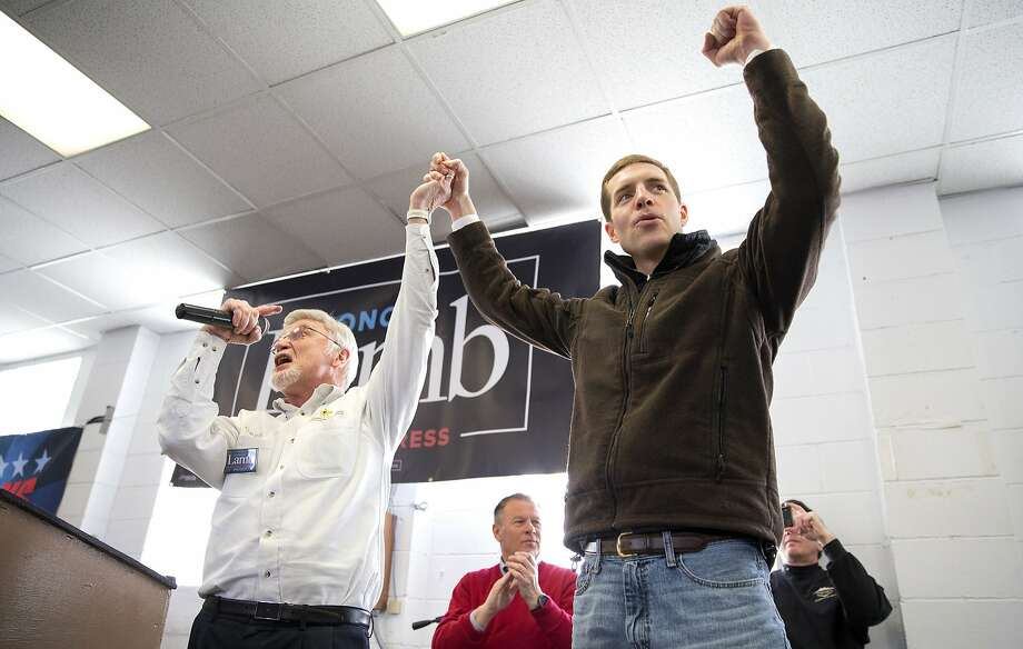 Cecil Roberts, president of the United Mine Workers, left, lifts up Democratic candidate Conor Lamb's hand as the crowd erupts in cheers and chants during a rally, Sunday, March 11, 2018, at the Greene County Fairgrounds in Waynesburg, Pa. Lamb is running against state Rep. Rick Saccone for Pennsylvania's 18th Congressional District in a special election on Tuesday. (Antonella Crescimbeni/Pittsburgh Post-Gazette via AP) Photo: Antonella Crescimbeni, Associated Press