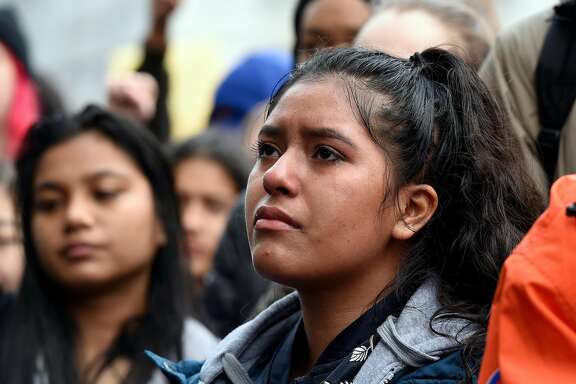 Tears roll down the cheek of Rut Hernandez of Lincoln High School as she joins students that walked out from over 20 different Bay Area schools and gathered in front City Hall in San Francisco, Calif., on Wednesday March 14, 2018. Students across the country participate in a national walkout to oppose gun violence.