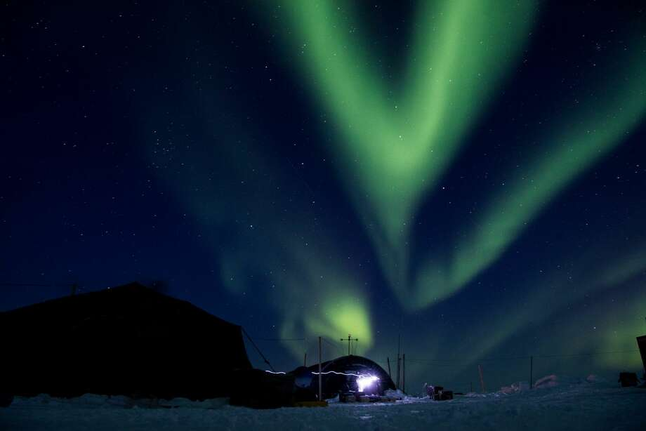 Ice Camp Skate as the aurora borealis displays above camp March 9, 2018 in support of Ice Exercise (ICEX) 2018. ICEX 2018 is a five-week exercise that allows the Navy to assess its operational readiness in the Arctic, increase experience in the region, advance understanding of the Arctic environment, and continue to develop relationships with other services, allies and partner organizations. (U.S. Navy photo by Mass Communication 2nd Class Micheal H. Lee) Photo: Petty Officer 2nd Class Michael Lee/Commander Submarine Forces Pacific