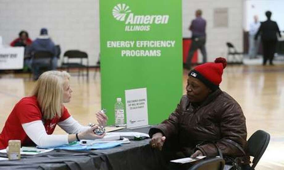 Angela Holloway, an Ameren Illinois energy efficiency consultant, meets with a customer to discuss energy efficiency and methods to reduce energy costs. Photo: For The Telegraph