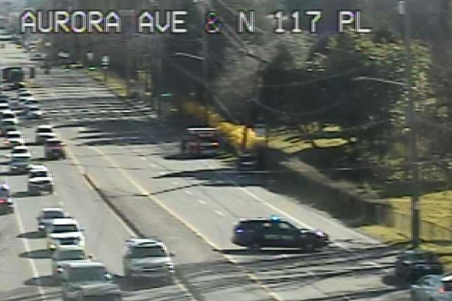 Both directions of Aurora Avenue North are closed to traffic in the  area of North 115th Street after a car reportedly ran into a pole,  according to local agencies. Photo: SDOT