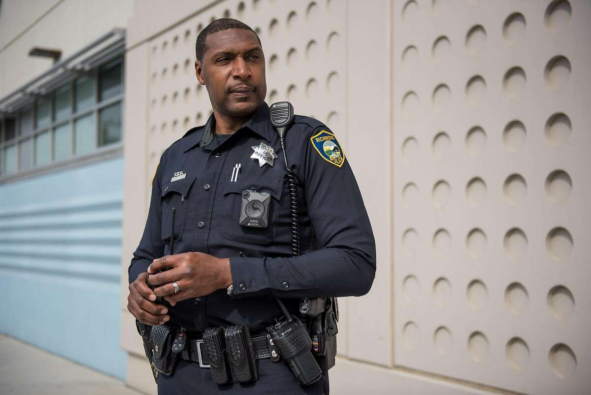 Officer Gary Lewis stands for a portrait outside Sylvester Greenwood Academy on Friday, March 9 2018. Officer Lewis is the school�s Student Resource Officer (SRO). Richmond school board may defund SROs over concerns about a �school-to-prison� culture in the city.