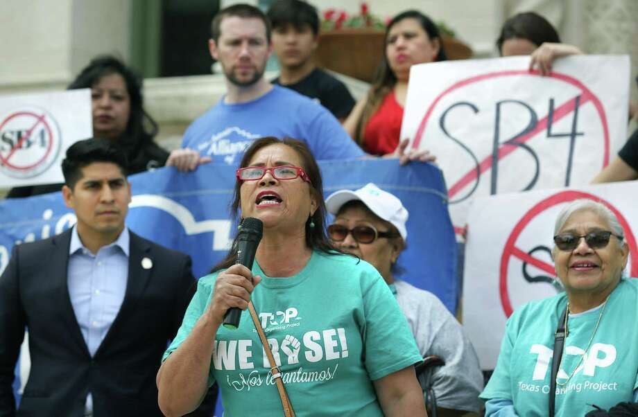 Maria Victoria de la Cruz speaks as members of protesters gather on the steps of City Hall to call for local policies that would limit the impact of Senate Bill 4, the so-called sanctuary cities ban. Photo: Bob Owen / San Antonio Express-News / ©2018 San Antonio Express-News