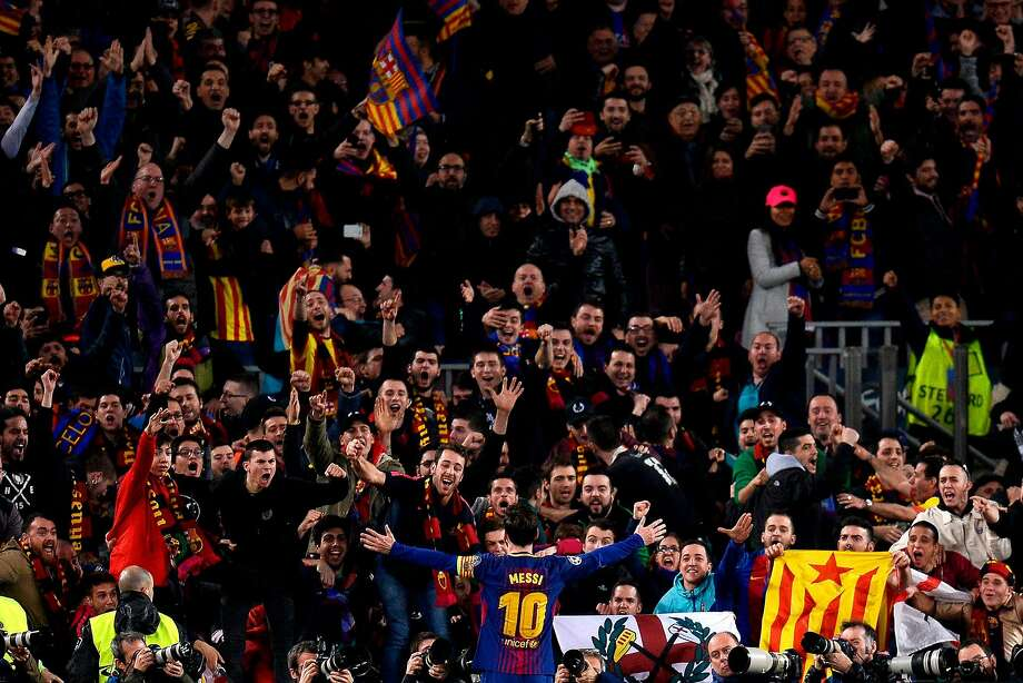Lionel Messi celebrates with Barcelona supporters after scoring his second goal in a 3-0 win over Chelsea to advance to the quarterfinals of the Champions League. Photo: JOSEP LAGO, AFP/Getty Images