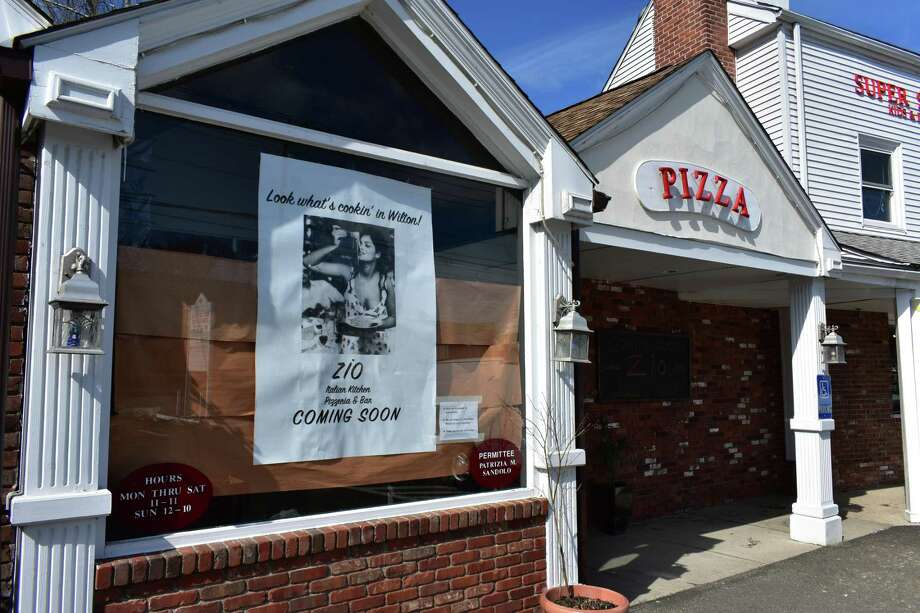 The former John's Best Pizza on March 14, 2018, at 1 Danbury Road in Wilton, Conn., with Zio Italian Kitchen Pizzeria & Bar the promised replacement within a few weeks. Photo: Alexander Soule / Hearst Connecticut Media / Stamford Advocate
