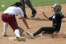 Edison's Mekiela Sibley slides into second base as Highlands' Alyssa Flores misses the throw in this game last season where Edison won 6-2. Sibley continues to be a top player for the Golden Bears; last week, the Bears' 20-0 win over Lanier started with Sibley's leadoff triple.