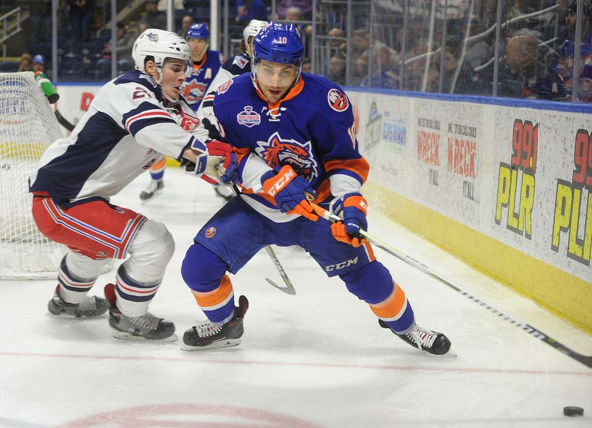 Bridgeport Sound Tiger Ryan Bourque is defended by Hartford's Ryan Graves behind the Wolf Pack net in the first period of their AHL hockey game at the Webster Bank Arena in Bridgeport, Conn. on Sunday, February 18, 2018.