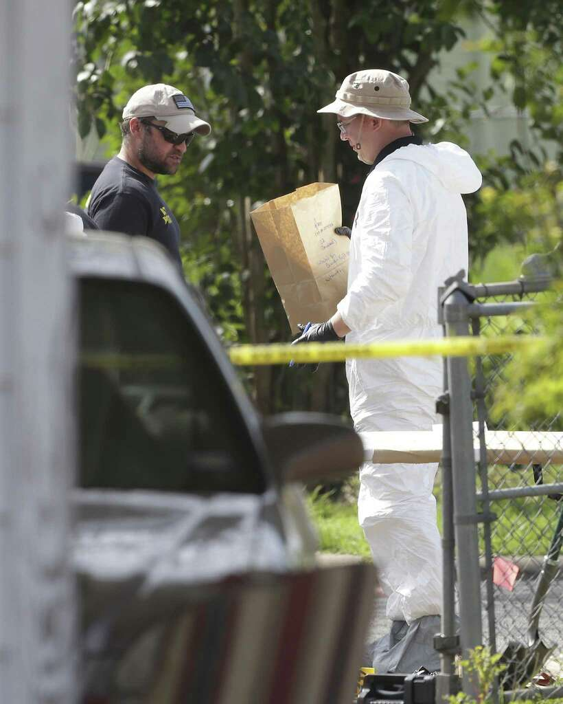 Agents Look Through Gathered Evidence As The Fbi Investigates The Site Of A Third Austining