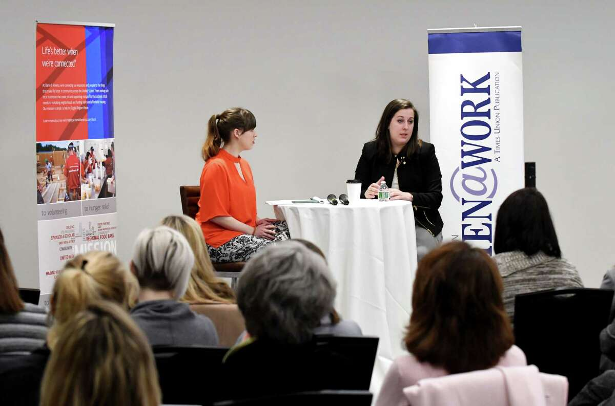 Colleen A. Costello, CEO and cofounder of Vital Vio, now called Vyv, right, speaks during a Women@Work Changemakers breakfast event, presented by Bank of America on Wednesday, March 14, 2018, at the Hearst Media Center in Colonie, N.Y. The talk was moderated by Sara Tracey, left. (Will Waldron/Times Union)