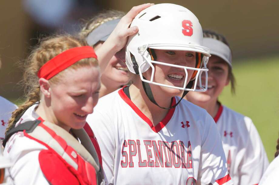 Splendora starting pitcher Gracie Bumpurs (9) reacts after hitting a grand-slam off Porter reliever Kendall Long during the fifth inning of a District 21-5A high school softball game at Splendora High School, Wednesday, March 14, 2018, in Splendora. Photo: Jason Fochtman, Staff Photographer / © 2018 Houston Chronicle