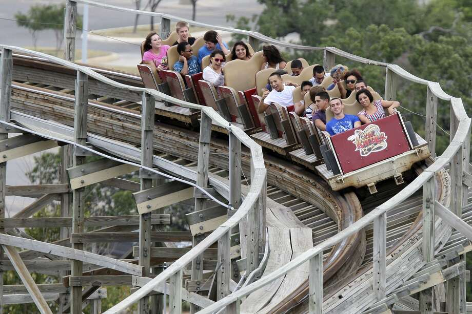 People ride the Rattler at Six Flag Fiesta Texas Aug. 5, 2012. The final ride for the wooden coaster was set for that night. Fiesta Texas closed the signature ride after 20 years in operation. Photo: Jerry Lara /San Antonio Express-News / © 2012 San Antonio Express-News