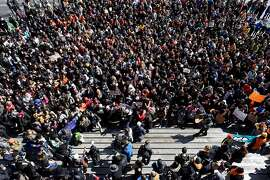 Students that walked out from over 20 different Bay Area schools gather in front City Hall in San Francisco, Calif., on Wednesday March 14, 2018. Students across the country participate in a national walkout to oppose gun violence.