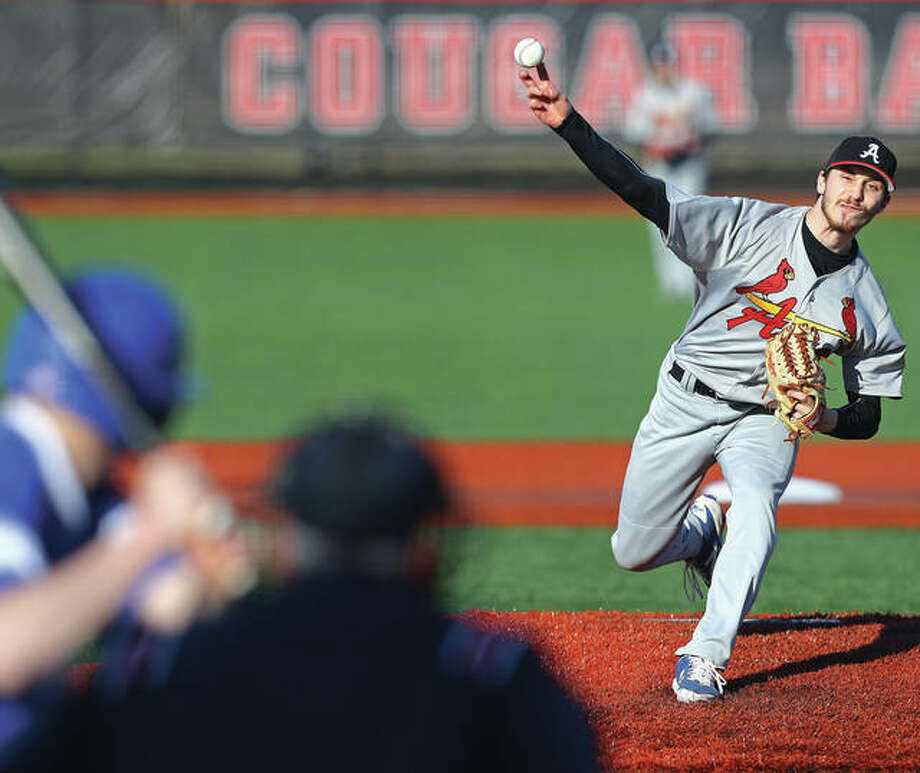 Alton Redbirds pitcher Charlie Erler delivers a pitch to a Freeburg batter during Wednesday's season opener at SIUE. The Redbirds lost 2-1.