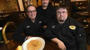 From left, Paul Valente, Jack Valente and Andy Valente pose with a bowl of Mac-n-Cheese at Valente's Restaurant on Tuesday, Feb. 7, 2017 in Watervliet, N.Y.