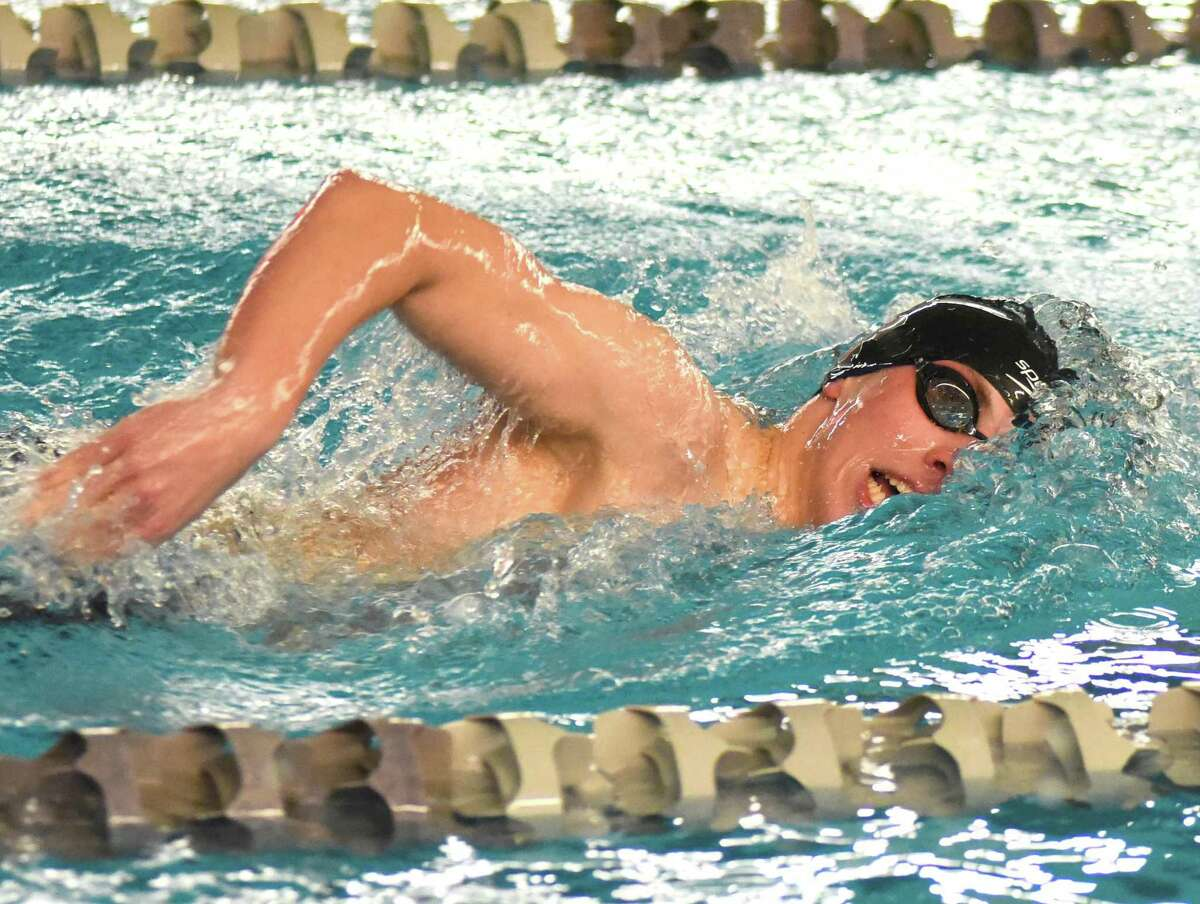 Timothy Osika of Brookfield powers through the water during the 500 freestyle at Wednesday's CIAC Class S swim championship meet in West Hartford.