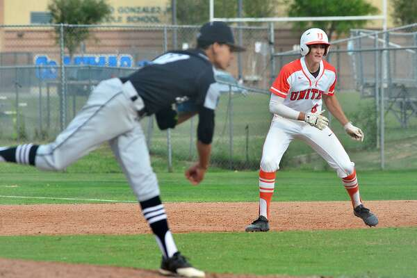 United's Marcos Alvarado takes a lead of first base Wednesday as United South's Marco Raya delivers a pitch. The Longhorns won 6-1.