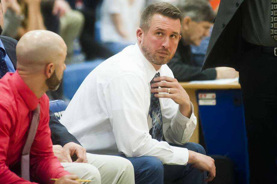 Meridian assistant coach Derek Fillmore checks the scoreboard during the Mustangs' regionals victory over Mason County Central on Wednesday, March 14, 2018 at Beal City High School. (Katy Kildee/kkildee@mdn.net) Photo: (Katy Kildee/kkildee@mdn.net)
